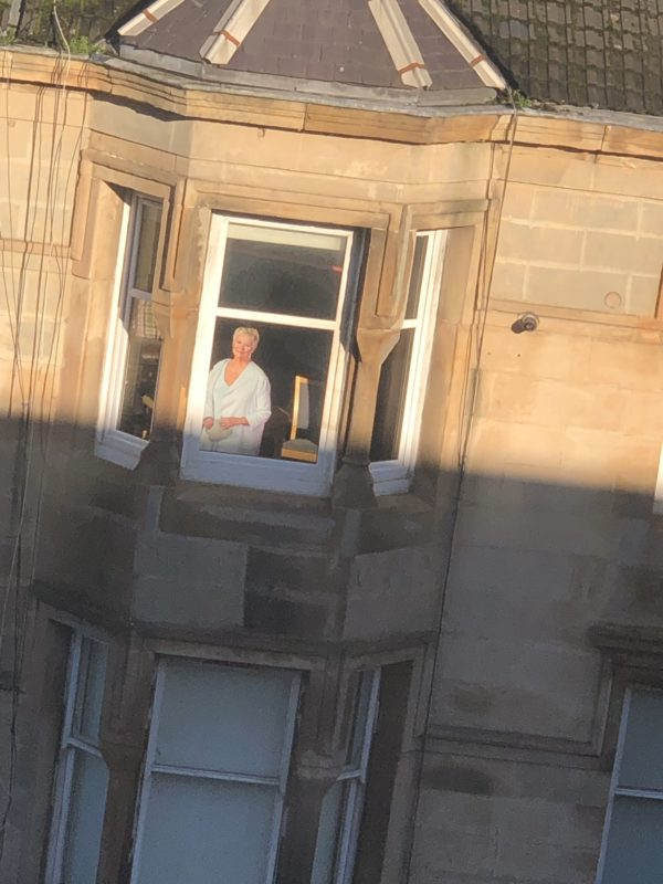 Cutting Judi Dench's cardboard out of the apartment leaves Glaswegians perplexed